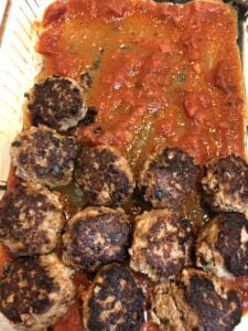 Adding Meatballs to 9 X 13 Pan Spread with Marinara Sauce