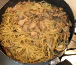 Adding the Pasta to the Garlic Butter Sauce