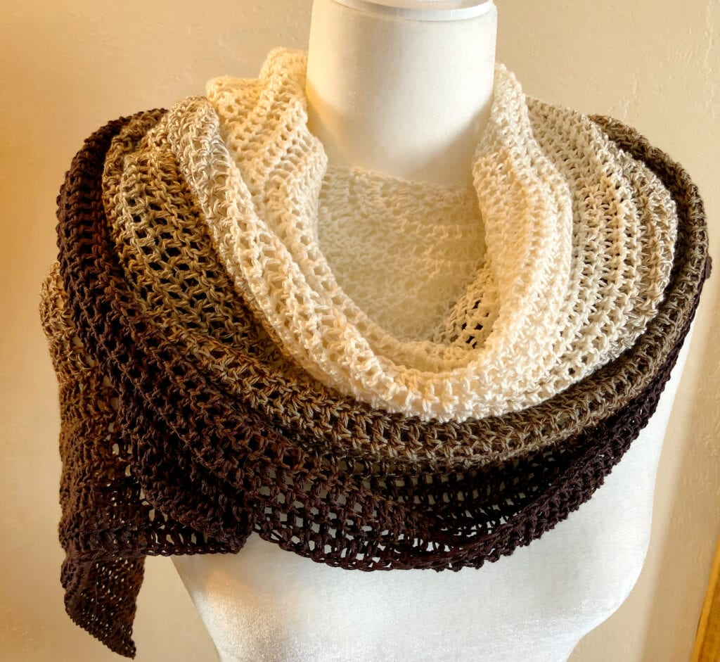 Tan and Brown Crochet Shawl Wrapped Over Shoulders