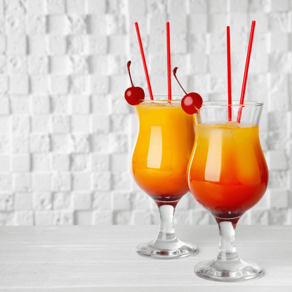 Amaretto Sunrise Mimosa Drink with Maraschino Cherries