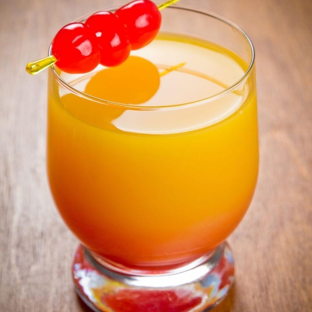 Sunrise Drink Garnished with Maraschino Cherries