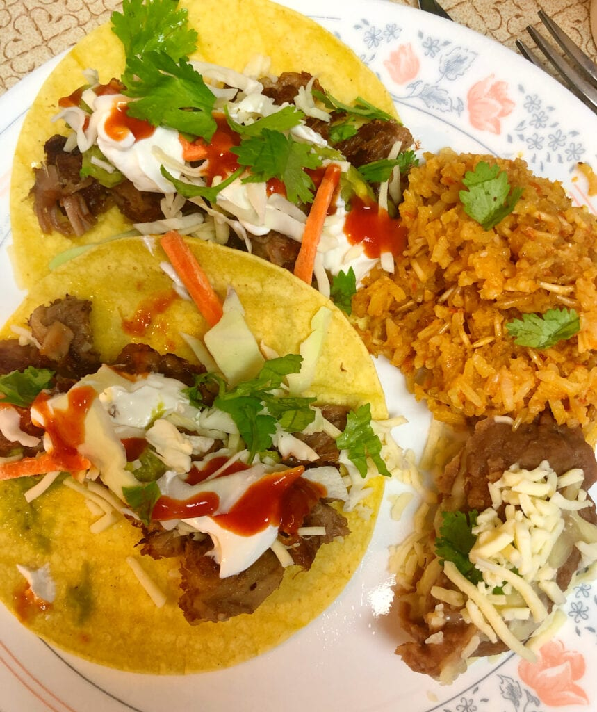 Pork Carnitas with Refried Beans and Spanish Rice