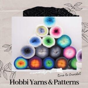 Stack of beautiful yarn cakes in fingering yarn