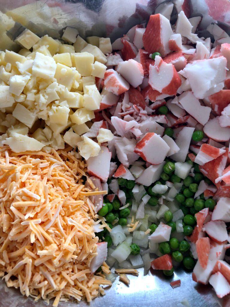 Imitation Crab Salad Ingredients in Mixing Bowl