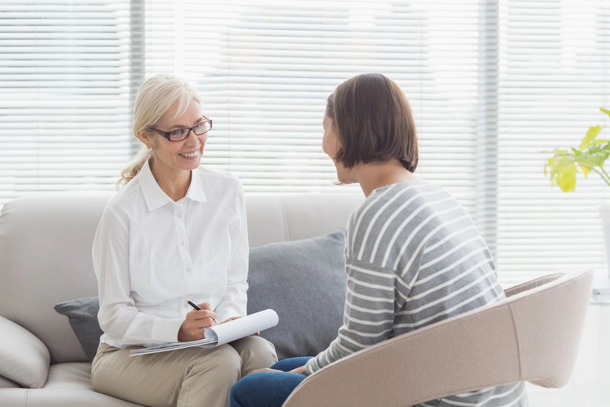 Woman and counselor chatting