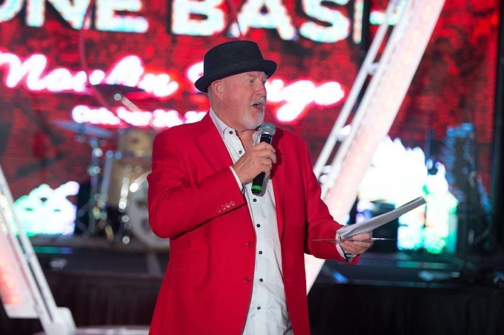 auctioneer performs live charity auction
