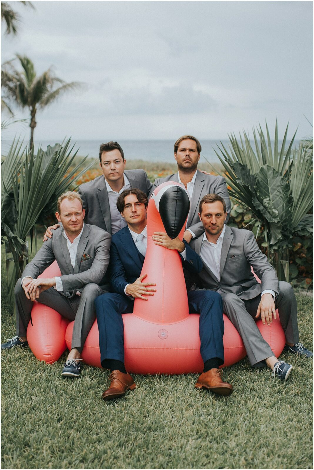 groomsmen with flamingo float