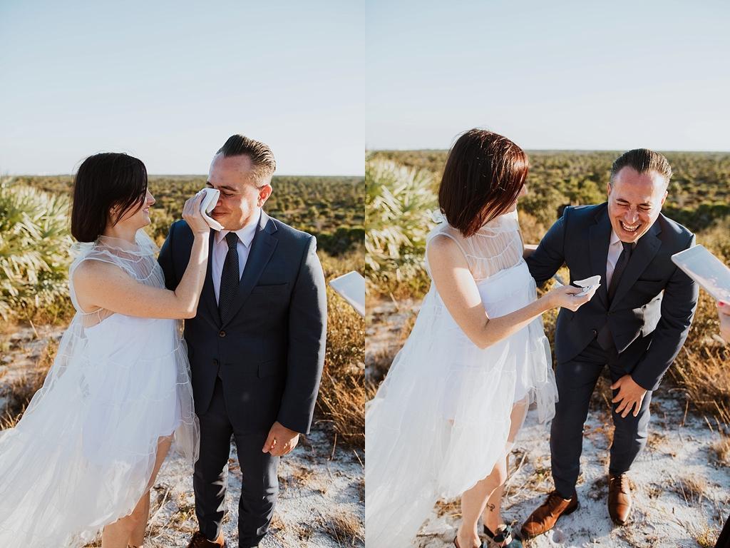 bride wiping her grooms tears