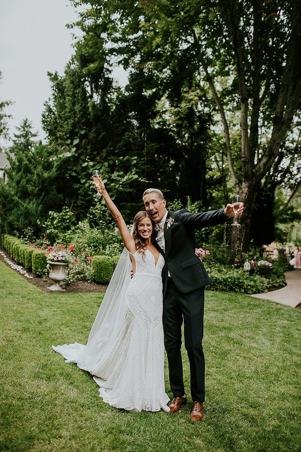 excited wedding couple