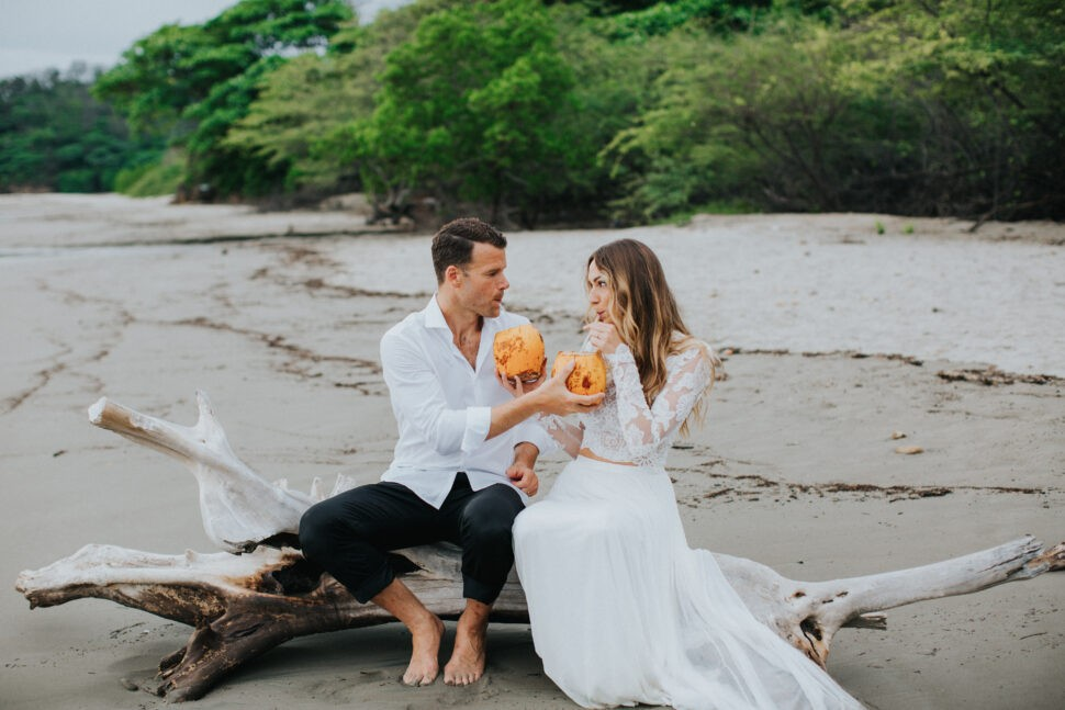 bride and groom have a quiet moment on the beach
