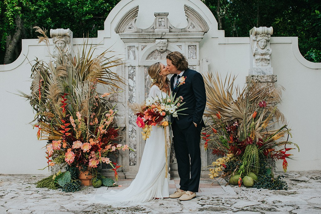 boho wedding ceremony at the bonnet house and gardens
