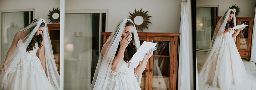 Bride reading a sweet note from her groom