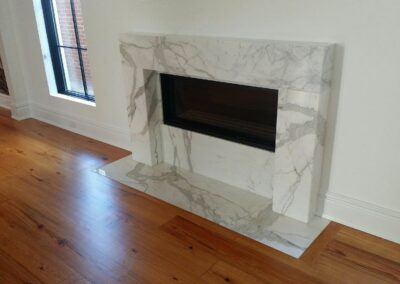 Calacatta Gold Marble with Mitered inside surround.