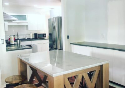 Wood Island with White Stone Countertop