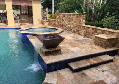 Classic Travertine, French patterned pool deck and back wall.