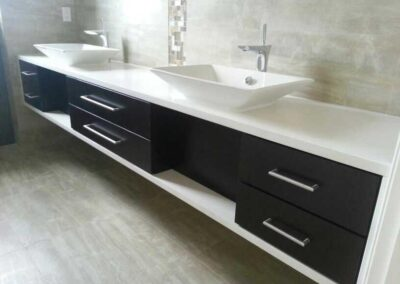 White Quarts with straight edge and vessel sinks.