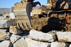 Rock Wall-Excavator Claw-Rock Delivery