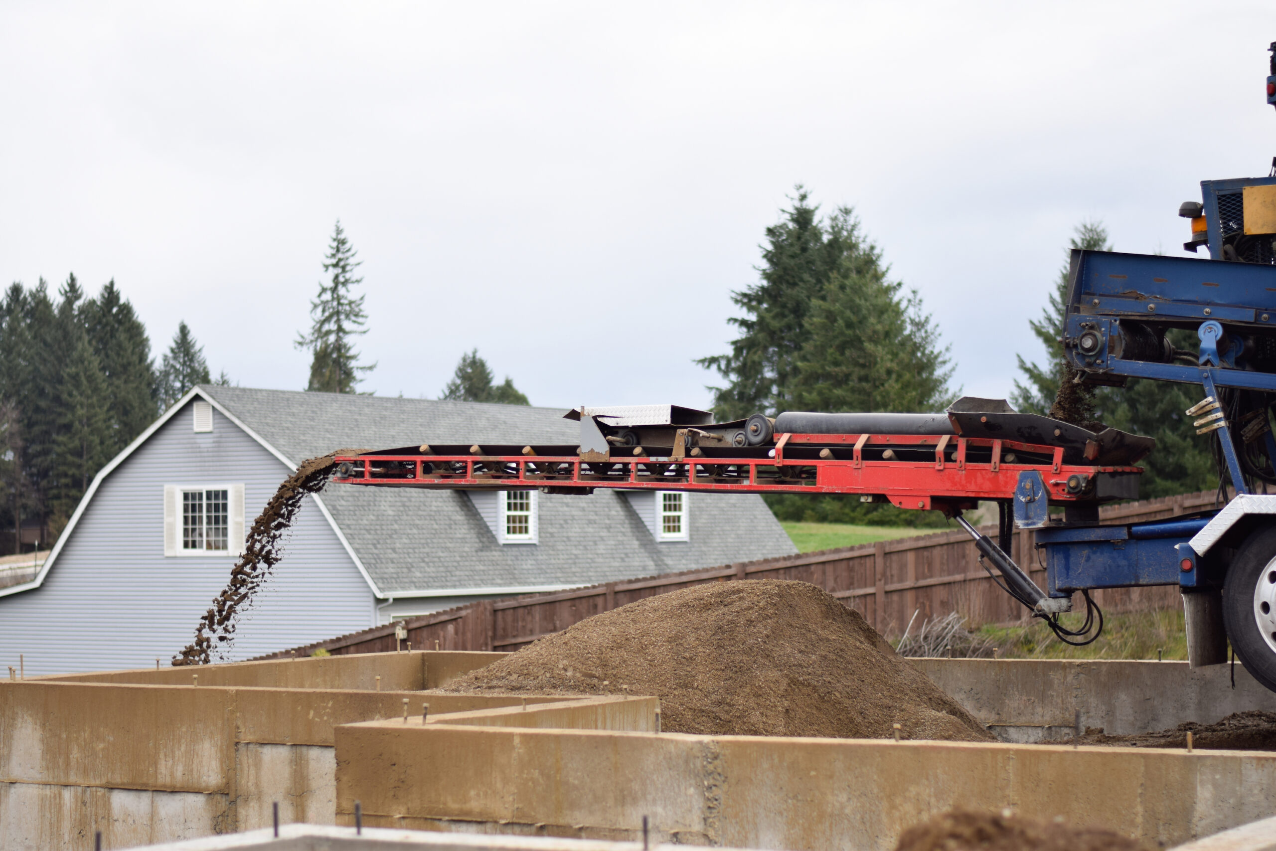 Breaking Ground Conveyor Services completing a soil delivery project