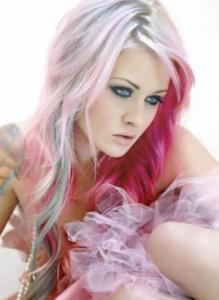 Pastel pink hair on tattooed model