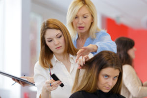 cosmetology student learning to do hair