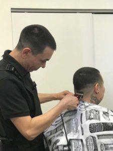 student barbering