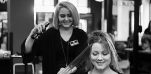 Cosmetology student doing hair