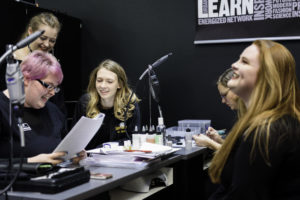 Students learning manicuring