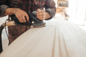 person sanding wood