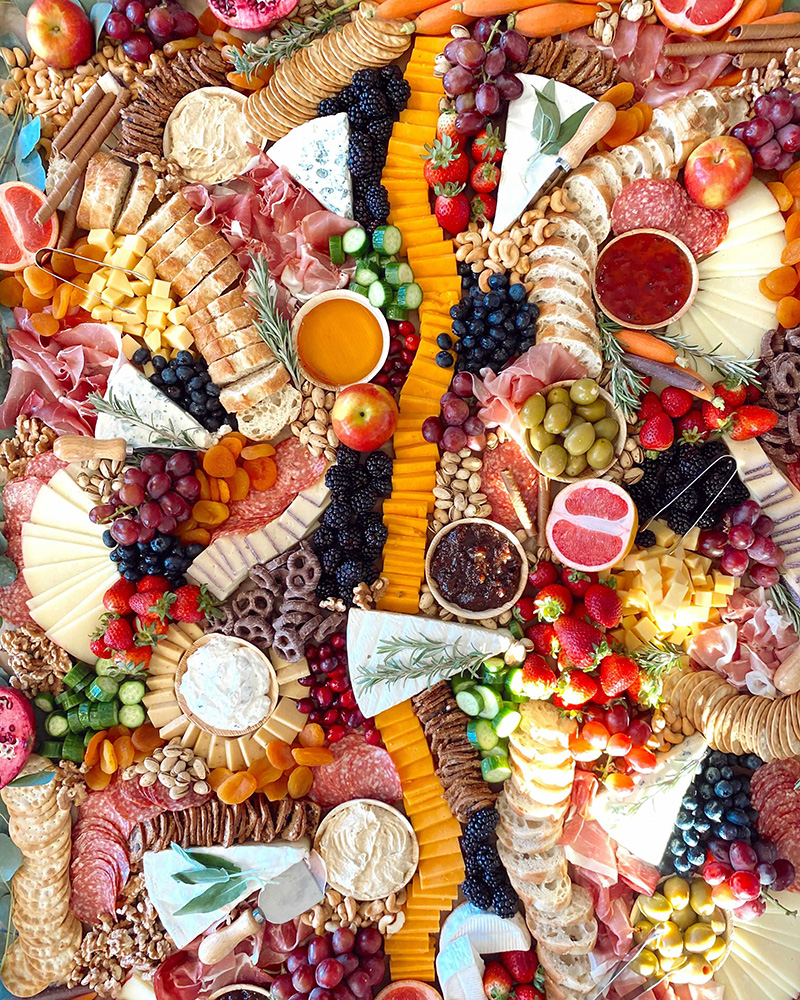 overhead view of large charcuterie grazing table