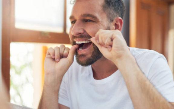 Proper Method To Floss Teeth
