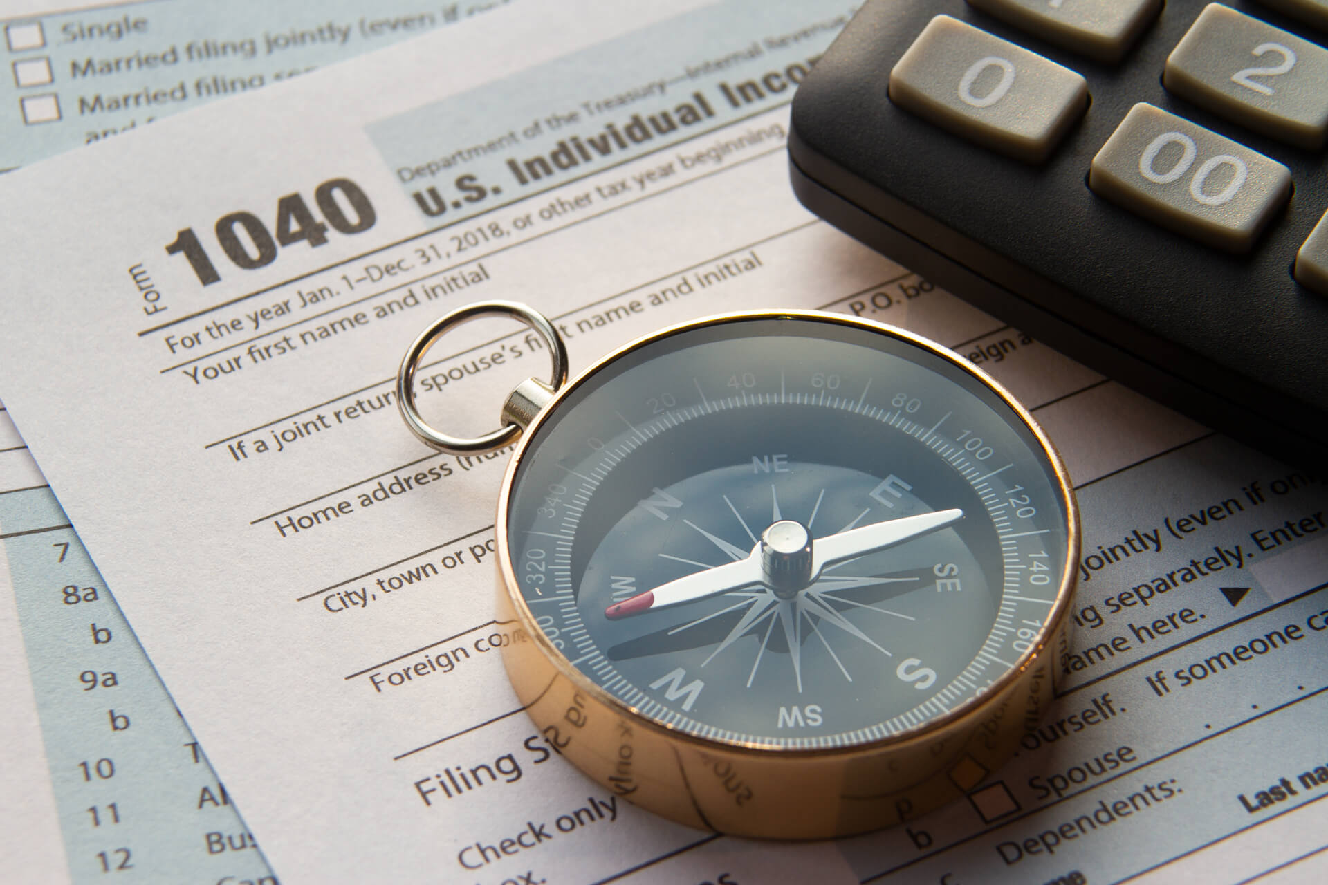 compass, calculator, 1040 tax form, strategic tax resolution