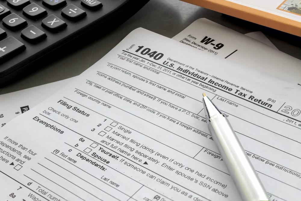 1040 tax form, tax, calculator, pen, irs, strategic tax resolution