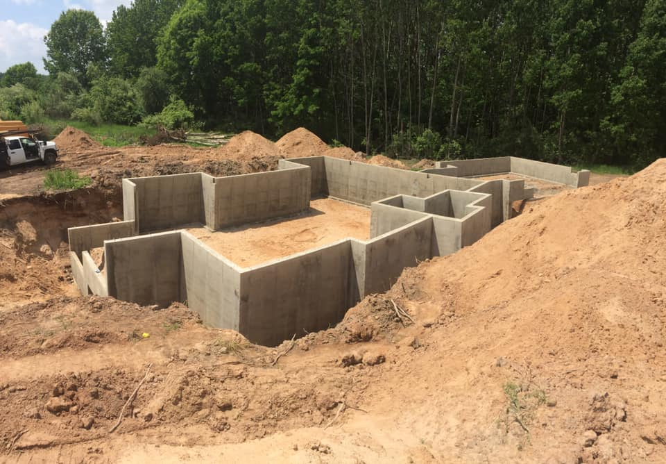 concrete poured walls project in sand