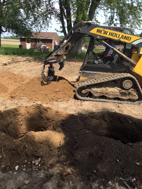 Using skid steer to dig and pour piers
