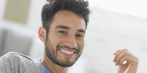Man smiling after dental implants Beverly Hills dentist