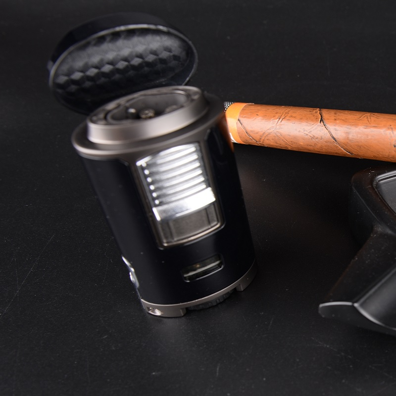 cigar lighter with punch cutter