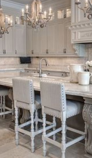 a kitchen with white furnishings