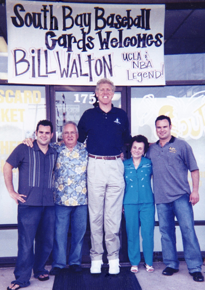 From left to right: Brett Allen, Ian Allen, Bill Walton, Sharilyn Allen and Scott Allen in front of the shop for an Upper Deck sponsored signing.
