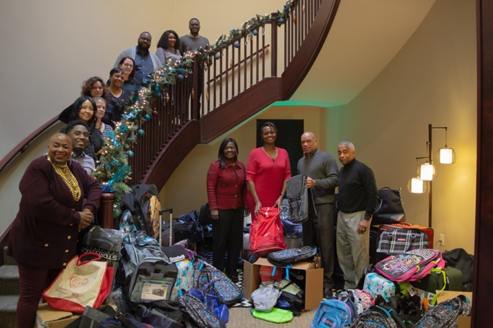 Argent Associates Donates Bags and Bikes for the Holiday Season