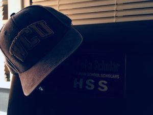 University Hat on Headboard