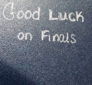 Finals wishes written on desk