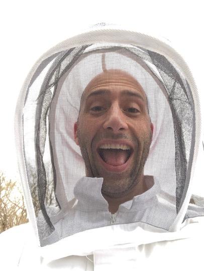 man in beekeeper gear