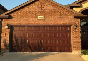 Garage door installed on a nice house.