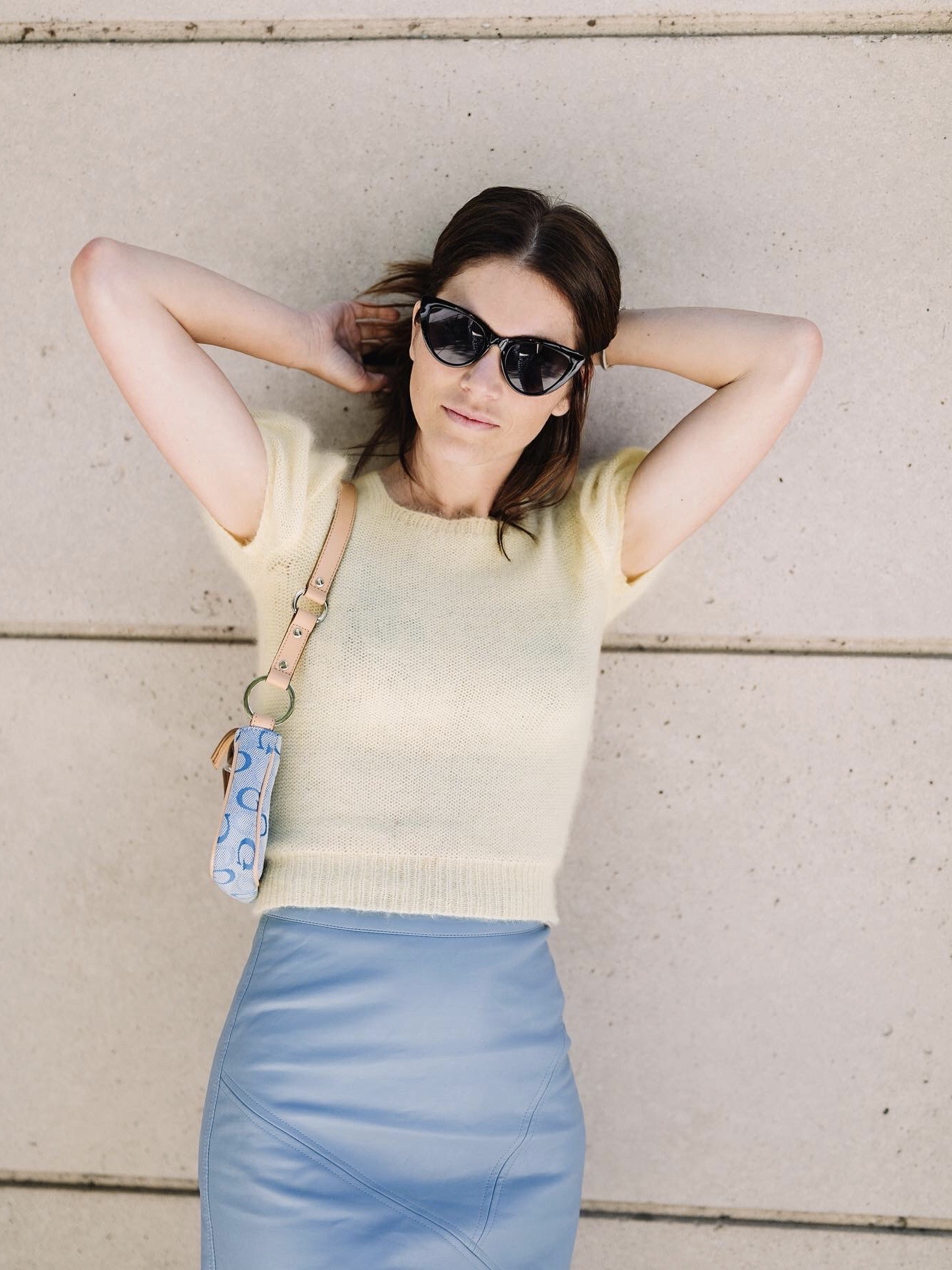 baby blue leather skirt and pale yellow sweater