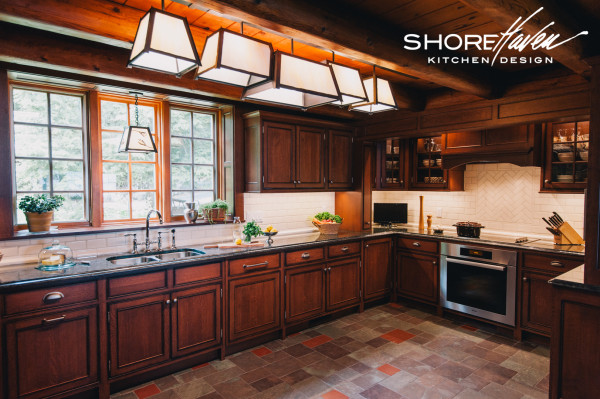 Quarter sawn white oak cabinetry and mottled purple and red slate tile floor.