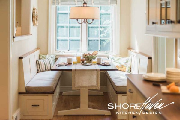 Built-in banquette nook with bench seats and trestle table handmade by ShoreHaven Kitchens