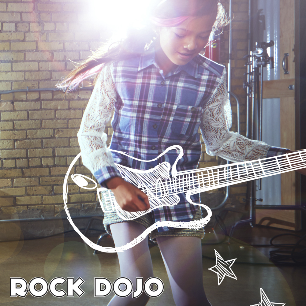 Girl playing a guitar after getting on demend video lessons from Rock Dojo