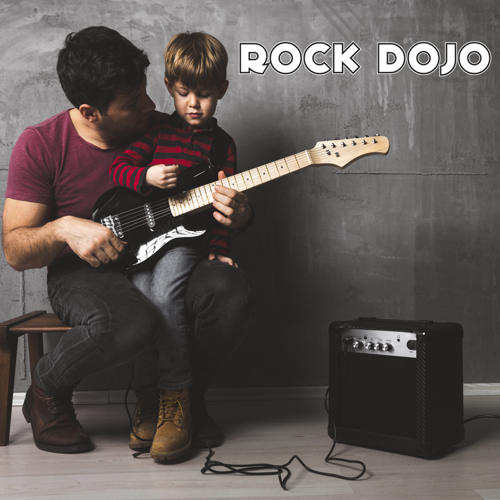 A father teaching his son how to play guitar. Benefits of music Education