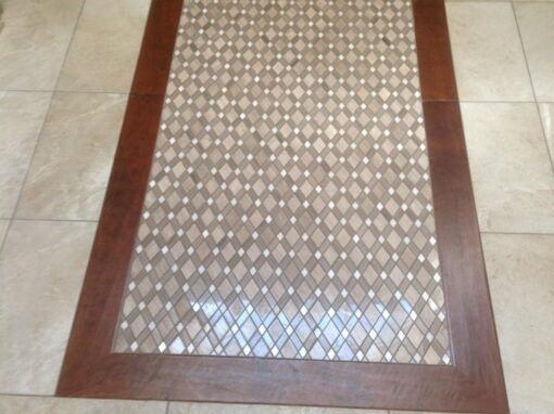Wood framed mosiac tile floor