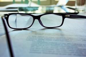 glasses on a manuscript